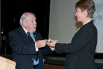M.W. Bro. Daniels presenting an engraved Quaich to Dr. Harland-Jacobs