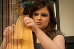 Harpist playing before the lecture