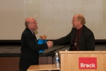 Dr. Murray Wickett, Chair Department of History (right) presenting Dr. Bullock with a gift